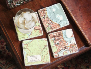 Custom Map Coasters from ScreenCraft Gifts. Comes with stand.