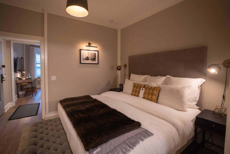 HGU New York King Suite bedroom space.