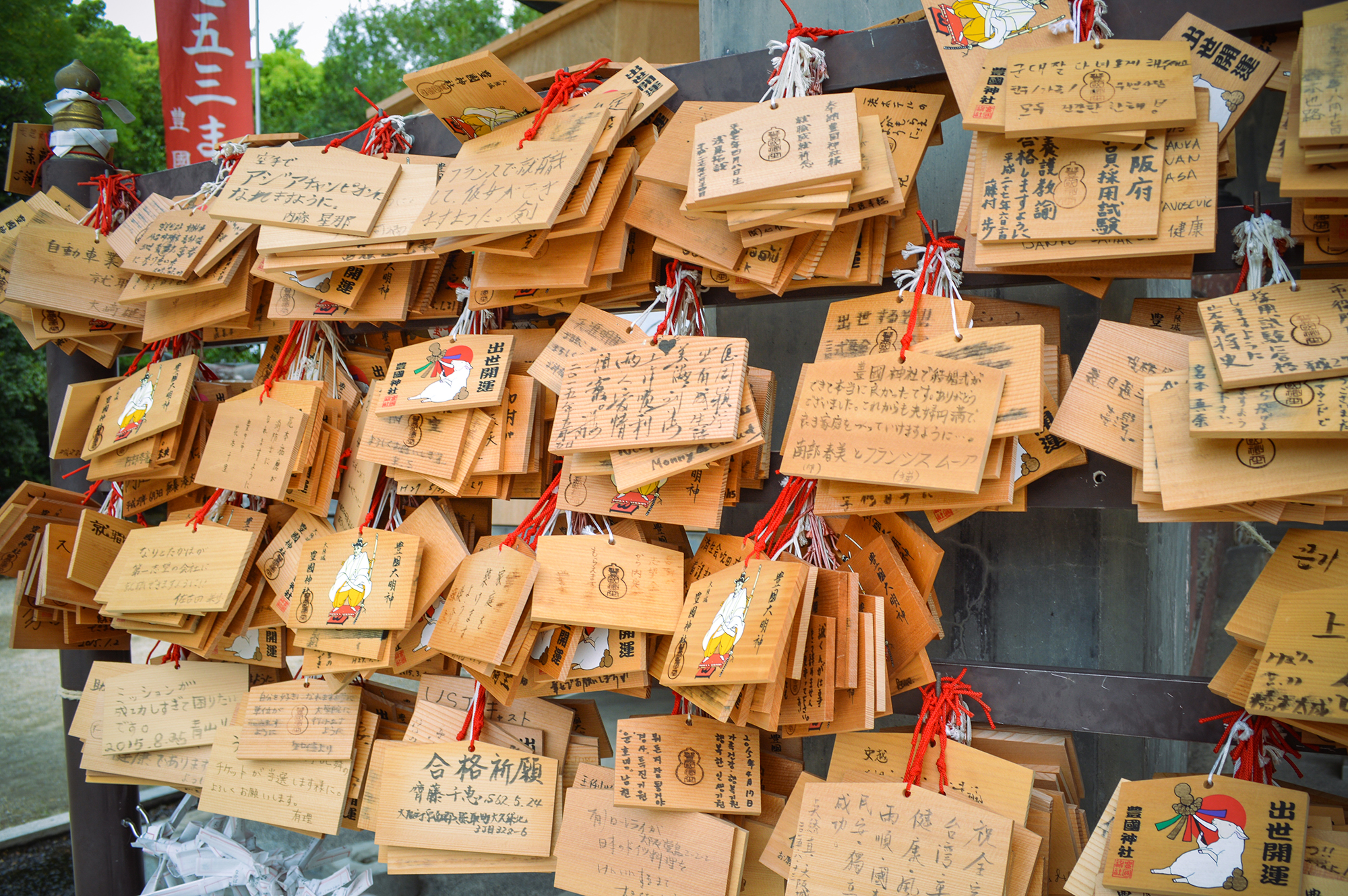 These wooden wish boards are called ema in Japanese.