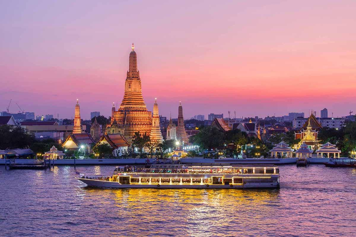 Wat Arun photographed from across the river during sunset.