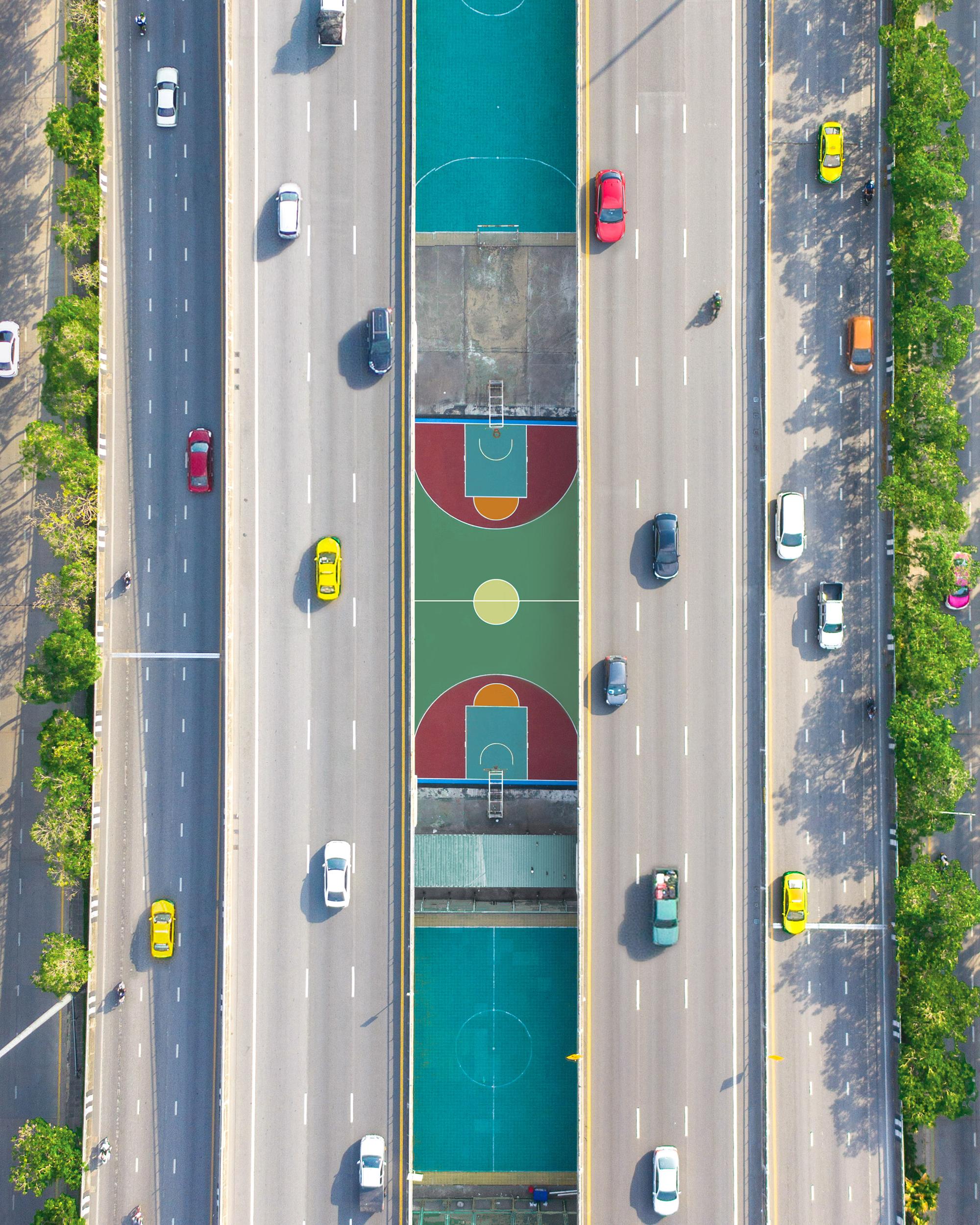 Basketball court nestled in between major highways in Bangkok.