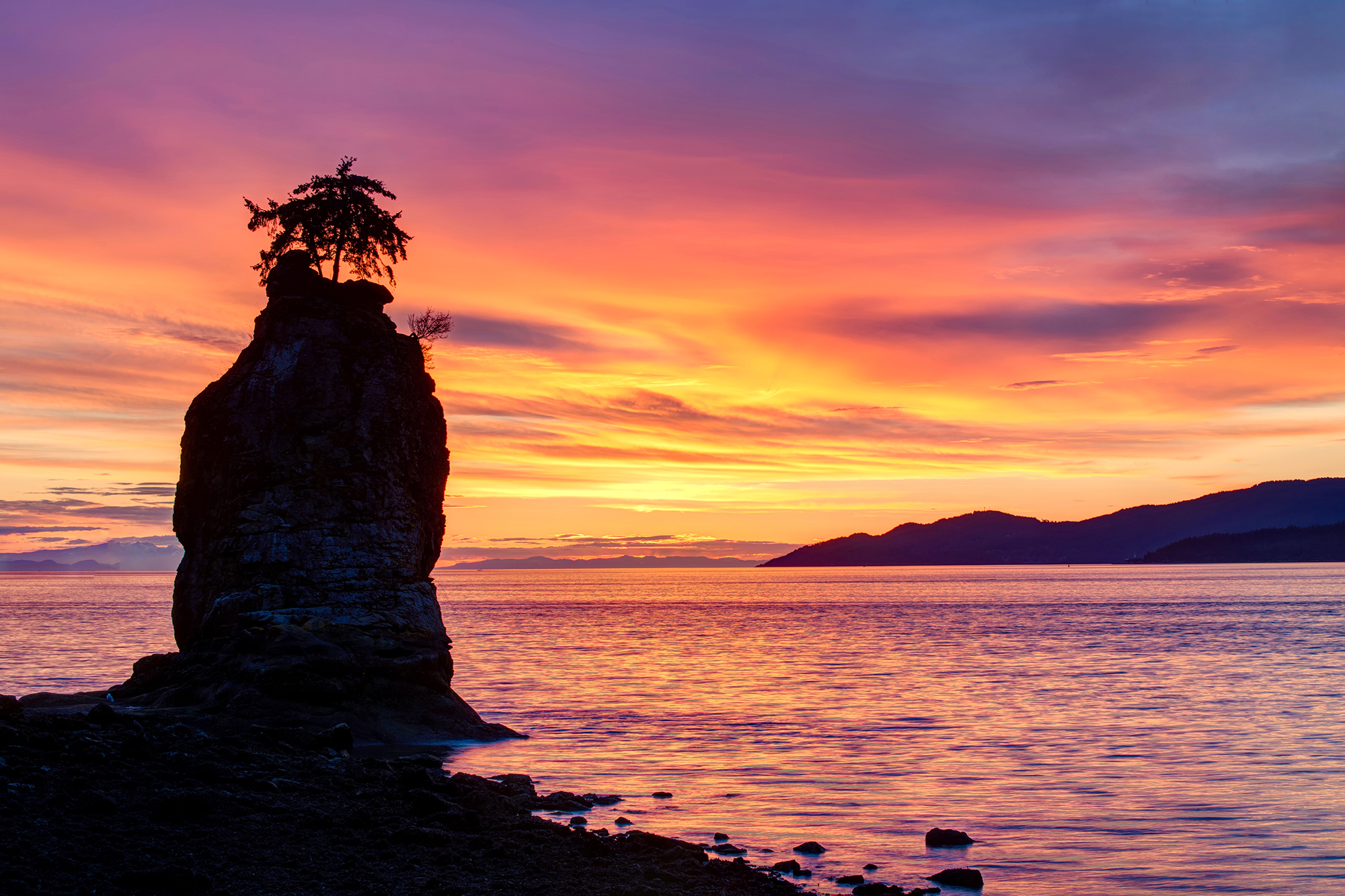 Sunset overlooking Stanley Park's Siwash Rock.